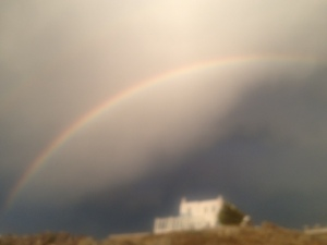 iPhone cameras can't capture double rainbows.  Apparently Steve Jobs was human, after all.
